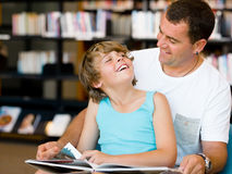 Father with son in library Royalty Free Stock Images