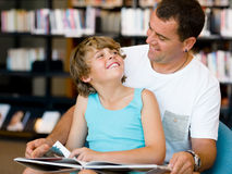 Father with son in library Stock Image