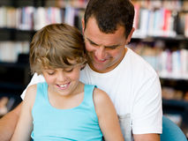 Father with son in library Royalty Free Stock Photos