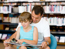 Father with son in library Royalty Free Stock Photo
