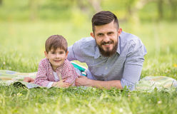 Father and son. Little boy and his dad enjoying their time together outside in nature Royalty Free Stock Photo