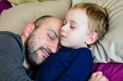 Father and son. Little cute boy sleeping with his father.Love concept royalty free stock images
