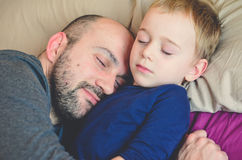 Father and son. Little cute boy sleeping with his father.Love concept stock images