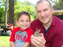 Father, son and little rabbit Royalty Free Stock Photos