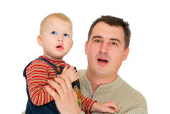 Father and son look with open mouth. Isolated on white Stock Photo