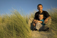 Father And Son Looking Away Royalty Free Stock Images