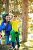 Father and son looking through binoculars. In nature Stock Images