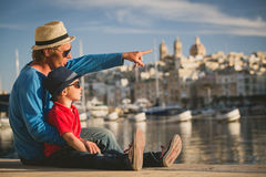 Father and son looking at city of Valetta, Malta Royalty Free Stock Images