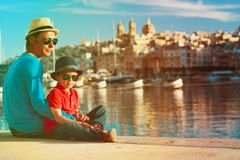 Father and son looking at city of Valetta, Malta. Travel concept Stock Photography