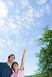 Father and son looking at clouds Stock Images