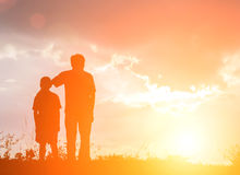 Father and son looking for future,  silhouette concept. Father stand beside son looking for future,  silhouette concept Royalty Free Stock Images
