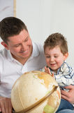 Father and son looking at globe Royalty Free Stock Photos