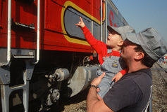 Father and son looking at historic train Royalty Free Stock Image