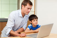 Father and son looking at laptop Royalty Free Stock Image