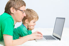 Father and son looking at laptop Stock Photos
