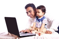 Father and son looking at laptop Stock Photo