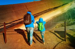 Father and son looking at lava in Teide volcano, Tenerife. Family travel Royalty Free Stock Photos