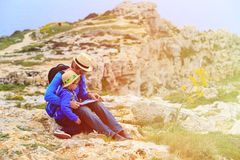 Father and son looking at map in mountains Stock Images