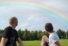 Father and son looking at a rainbow Stock Photos