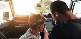 Father and son looking for route on map Stock Images