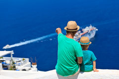 Father and son looking at Santorini, Greece Stock Photos