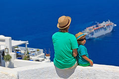 Father and son looking at Santorini, Greece Stock Images