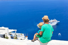 Father and son looking at Santorini, Greece Royalty Free Stock Images