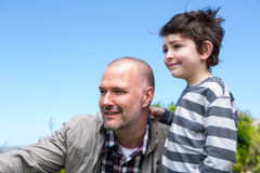 Father and son looking at something. In the countryside Royalty Free Stock Photos