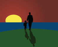 Father and son looking at sunset Royalty Free Stock Photo
