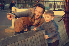Father and son looking at the sunset together. Royalty Free Stock Image