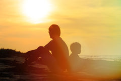 Father and son looking at sunset. On tropical beach Royalty Free Stock Image
