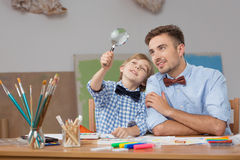 Father and son with magnifier Royalty Free Stock Images