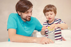 Father and son make lemonade Royalty Free Stock Photo