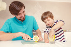 Father and son make lemonade Stock Photos