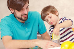 Father and son make lemonade Stock Photography