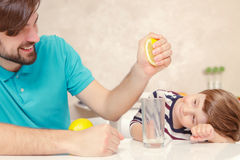 Father and son make lemonade Stock Images