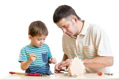 Father and son make nesting box together Stock Image