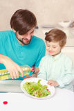 Father and son make salad dressing Royalty Free Stock Photo