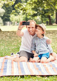 Father and son make a self photo on picknik Royalty Free Stock Image