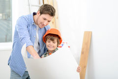 Father and son making renovation at home Stock Photo