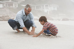 Father And Son Making Sand Castle Royalty Free Stock Photography