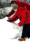 Father And Son Making Snowman Stock Images