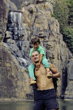 Father and son making a trip to waterfall together, happy family on vacations, nature place pongour Royalty Free Stock Photos