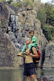 Father and son making a trip to waterfall together, happy family on vacations, nature place pongour Stock Photos