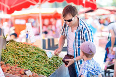 Father and son at market Royalty Free Stock Photos