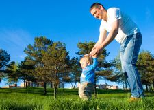 Father and son in the meadow Stock Photography