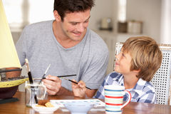 Father and son model making Stock Photos