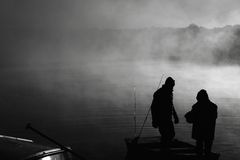 Father Son Morning Fishing Trip. A father and son preparing for an early morning fishing trip Royalty Free Stock Images