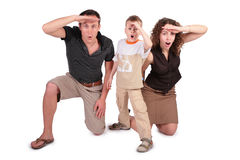 Father, the son and mother have seen something. And are surprised stock images