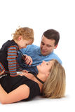 Father with son and mother in one bead Royalty Free Stock Images